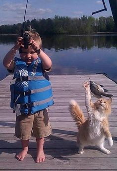 Boy & his cat ~Nice catch! I'll take it from here…