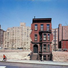 """From the August 10 1959 issue of LIFE magazine: """"Solitary survivor on block cleared for 20-story building. A still-occupied brownstone in East 60s forlornly awaits the inevitable."""" This image appeared in a story about a big construction boom in NYC. (Dmitri KesselThe LIFE Picture Collection/Getty Images) by life"""