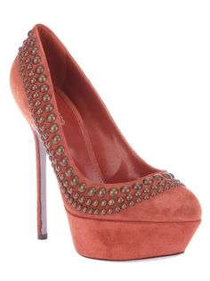 Burnt orange suede pump from Sergio Rossi featuring a round toe, a suede covered platform, a leather sole, a stiletto heel, and a brass-tone studded top trim.