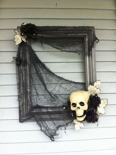 """Halloween """"wreath"""" I just made using and old frame and some dollar store decorations."""