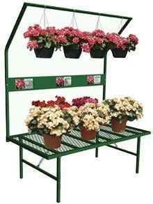Folding Display Table - table with hanging basket purlin . $258.00. The new FTT300 folding table display is a workhorse for your garden center and greenhouse. It will display flats, small pots, large pots and hanging baskets with ease. The heavy-duty construction will hold most any live product or hard goods that you need to display. The expanded metal table top allows you to display a wide variety of sizes and the standard powder-coated finish will look great inside or out. Opt...