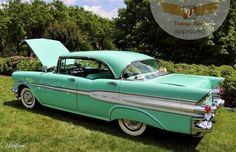 Turquoise 1950's automobile . . . don't know the model.  It could be a '57 pontiac.  Then again, maybe not.