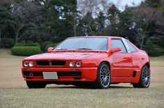 1990-1996 Maserati Shamal.  Less than 400 were produced. Came equipped with a 3.2 L twin turbo V8 and a top speed of 170mph.