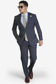 Suit includes jacket & trousers 2-button single breast jacket Notch lapels Flap pockets Side vents Suit includes jacket & trousers Fit: Slim Fit Comfort: Stretch Armhole for comfort Material: 98% Wool 2% Spandex Color: Blue Windowpane Plaid