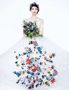 Tulle gown with Tree of Life embroideries by Valentino. Trinity Ruban platinum solitaire ring with diamonds by Cartier, price upon request. Bouquet by Gardenia Organic. Photo: Erik Madigan Heck