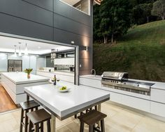 I like how the kitchen counter and island continue to the outdoor bbq area.