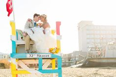 bride in dress on lifeguard tower