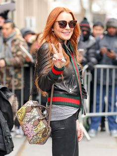 Lindsay Lohan in Gucci Ruffle leather bomber jacket (2500 EUR) with Gucci Bengal Top Handle Bag ($1850 / 1150 EUR).