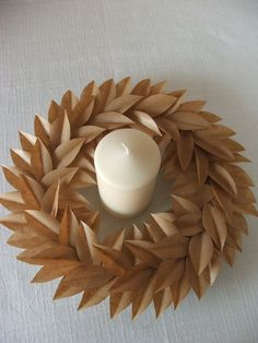Brown Paper Centerpiece/wreath.  The linked website is in Italian and when I translated it and scrolled I didn't see what looked like instructions... but I think it should be easy enough to figure out.