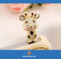 1PC Bling Crystal Tropic Animal Cute Giraffe Earphone Charm Cap Anti Dust Plug for iPhone 5, iPhone 4, Samsung S3. $5.99, via Etsy.