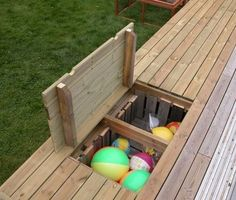 """I have a thing that I find difficult to get good storage for, namely the children's outdoor toys. Spades, buckets, water toys, balls … - All About Gardens Childrens Outdoor Toys, Deck Storage, Water Storage, Hidden Storage, Toy Storage, Storage Ideas, Water Toys, Above Ground Pool, Deck Design"