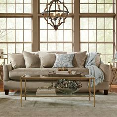 Refresh the living room or anchor your den with this timeless sofa, perfect topped with eye-catching pillows and cozy throws.