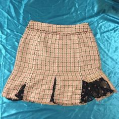 ECI Plaid Silk Skirt Polka Dots & Pink Jewels NWOT!! Such a beautiful skirt! I bought it cause I fell in 💕with it but it was too big so it's never been worn😢 I always custom gift wrap boutique style & include a free surprise!!🎁🎁 The absolutely the perfect skirt for work! Peekaboo polka dot material as a liner. 🎀Shell material; 55% Silk, 45% Acrylic 🎀 Lining; 100% Silk 🎀 Top inner lining; 100% Polyester. Lightweight and oh so VERY soft!!!! Adorable pink rhinestone crystals. You'll be…