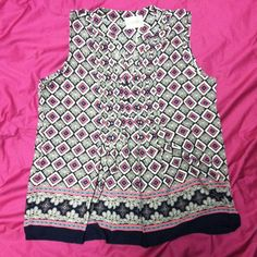 Short Sleeve V Neck Top This gorgeous retail shirt is silky smooth and incredibly stylish. All shirts offered for sale are still in plastic wrapping with tags and a button for repairs. The pictured shirt is my own and I get compliments all the time when I wear it! Currently I have 3 smalls and 2 mediums available Moon Collection Tops Blouses