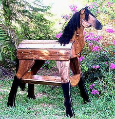 """This is a manufactured item, but an ambitious DIY""""er could probably do a decent job as well.  SaddleStandz® Horse Saddle Stand Saddle Rack Heavy Duty Elegant WALNUT finish"""