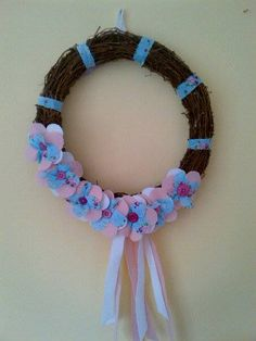 A 30cms wreath constructed using twigs and decorated with handcrafted flowers in a Cath Kidston style material