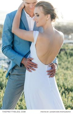 Incredible simple open back wedding dress designed by Robyn Roberts. Photography: Leandri Kers