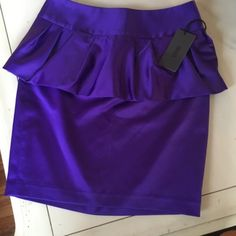 [ SALE [ The Limited ]  Forenza Peplum Skirt NWT FINAL PRICE Satin feel size 2 peplum skirt in rich purple. Final price drop so no offers please. Skirt is new with tags. Form fitted and would fit 0-2 - Prefer Buyers who understand and follow Poshmark guidelines. Feel free to ask questions. Thanks ☺️ The Limited Skirts Mini