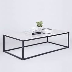 The Max Rectangular Coffee Table is made with a white Italian Carrara marble top on a black powder coated steel iron frame. Featured here is the By Lassen Frame Storage Box, and Small White Kubus Bowl. All available in our online store. Drum Coffee Table, Coffee Table Design Modern, Decor, Table, Living Room Table Metal, Metal Living Room, Coffee Table, Home Decor, Marble Top Coffee Table