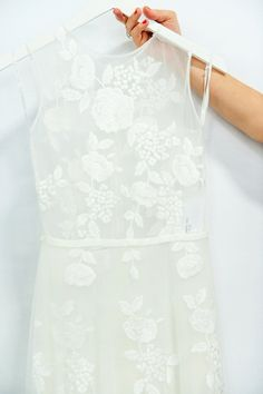 Anna Kara wedding dress.  Mooshki bride 1950s inspired wedding dress using rose/floral fabric.    Image from The White Gallery (2015), photographed by Emma Pilkington for Love My Dress®Wedding Blog.