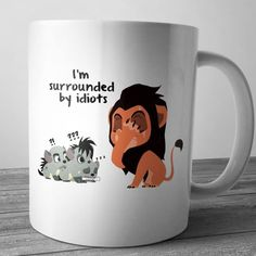 I want this mug so bad it's so cute and it's got a little Scar and a little Bonzai, Shenzi, and Ed!