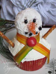 Snowman Cupcakes (use a powdered donut hole for the snowman's head...cute idea)