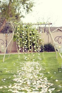 Homemade Wedding Arch - Several strings of flowers can be hung from the top beam to reach the ground, creating a beautiful backdrop to your wedding ceremony. 20 Cool Wedding Arch Ideas, http://hative.com/cool-wedding-arch-ideas/,