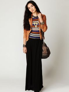 Black maxi skirt with striped top and leather jacket.