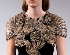 Fashion designer Iris van Herpen is a talent to watch with her avant garde take on fashion, and stints at Victor & Rolf and Alexander Mcqueen under her belt. For her last collection, Iris translates the concept of mummification into intricate techniques of wrapping and twisting cords of gold, bronze, and cream leather to form her garments. The result is a breathtakingly sculptural collection.
