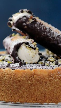 Enjoy a slice of cannoli with our cannoli crust cake made with a ricotta cheesecake filling and topped with rich, chocolate ganache.
