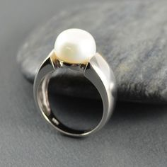 Classic and modern pearl ring. See more contemporary and unusual pearl jewellery in sterling silver from jewellers in Australia and overseas. Silver Pearl Ring, Silver Pearls, Silver Jewellery, Pearl Jewelry, White Freshwater Pearl, Simple Designs, Topaz, Stud Earrings, Jewels