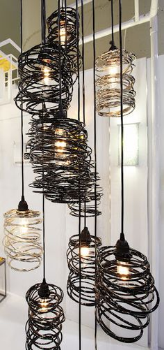 "spiral nest metal light fixtures by Ridgely Studio Works....these would look great in a high-ceilinged feading nook with a huge, comfy ""feature"" chair"