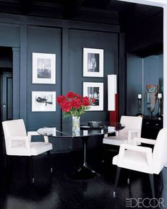 At his Manhattan apartment, fashion designer Gilles Mendel chose jet-black paint for the walls and floor of the dining room. A Saarinen Tulip table by Knoll adds a glossy touch to the space, while Leleu-style armchairs and photographs by Nereo and Günter Siever add graphic punch.