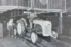 """12 By 18"""" Black & White Picture 8N Ford Tractor drive off Assembly Line"""