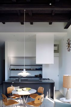Clean modern apartment with classic mid cent modern pieces by Eames, Noguchi, Poulsen and others