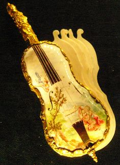 Delicate 18th century violin-shaped dance card, made of Dresden china & ivory (in museum collection at Musée Cognacq-Jay in Paris) ~ photo by fredpanassac, via Flickr [1st of two pins]