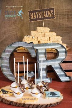 Love the rice crispie haystacks! Metal Letters from a Rustic Cowboys & Indians Birthday Party via Kara's Party Ideas | http://KarasPartyIdeas.com (20)