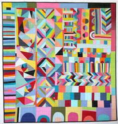 """Lucie Summers of Summersville made this amazing quilt. Not sure what's going on with these English women, but they are making some beautiful quilts these days. Although I think she started out with a bit of a plan, Lucie used an improvisational, piece-as-you-go method for making this quilt."""
