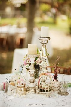 Wedding centerpiece candles for 10 & 12 top tables with wodden box arrangments, small vesels with 1 or 2 flowers in them.