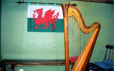 Two symbols of Wales - The Welsh Dragon on its flag and the Welsh harp  undiscoveredbritain.com