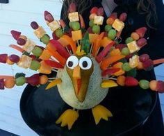Thanksgiving Edible Arrangement, (You can use pretzel sticks instead of toothpicks when serving to children)