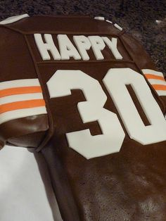 Cleveland Browns cake. Grooms cake, with last name.  Except I would make mine a reds cake! If its brown, flush it down :)