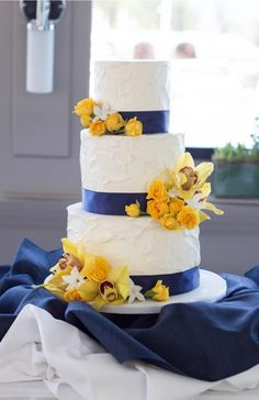Elegant nautical blue ribbon and yellow floral wedding cake; Featured Cake: Cake by Annie