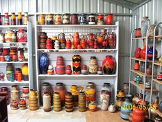 west german pottery from the 60s and 70s....i love collectiond at eye level and above on walls..this collection is amazing!!