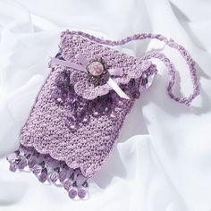 Victorian Princess Purse  As regal and refined as the royal reticule of a Victorian princess, this dainty thread purse, embellished with lustrous bead and button trims, is a stunning accent for today's high-fashion formal wear.  Size 10 cotton thread, D and steel hook #5
