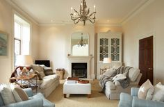 Old and new sophistication, pale blue, gold, chandelier, calm interior