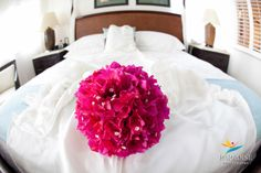 Traditional Caribbean bridal bouquet with wedding dress in one of Provos beautiful resort suites. Captured by Paradise Photography  www.myparadisephoto.com