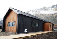 Cedar and Black Cladding Alpine Tray Roofing Wing Walled Gables Eco Home House Exterior