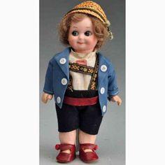 http://www.historytoy.com/Marseille-Armand-253-11/0-Bisque-socket-head-Googly-doll