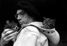 GB. Paul Gallico with his cats, 1952, by George Rodger